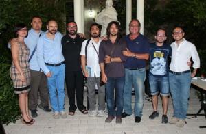 """Cristian Guzzo (terzo da sx) con gli organizzatori e una delegazione della compagnia """"Milites Friderici II"""""""